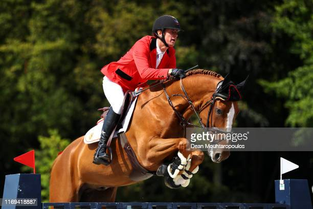 Jos Verlooy of Belgium riding Igor competes during Day 3 of the Longines FEI Jumping European Championship speed competition against the clock...