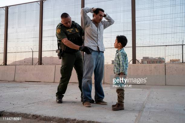 José with his son José Daniel is searched by US Customs and Border Protection Agent Frank Pino May 16 in El Paso Texas Father and son spent a month...