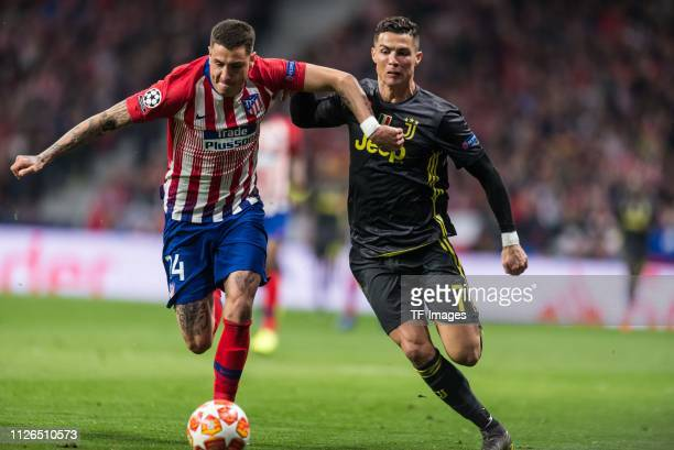 Josa Maria Gimenez of Atletico Madrid and Cristiano Ronaldo of Juventus battle for the ball during the UEFA Champions League Round of 16 First Leg...