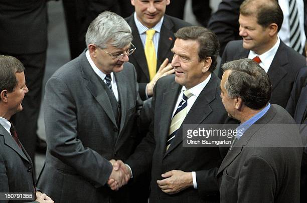 Joschka FISCHER , federal minister for foreign affairs, congratulates Gerhard SCHROEDER to the election as the federal chancellor in the plenary of...