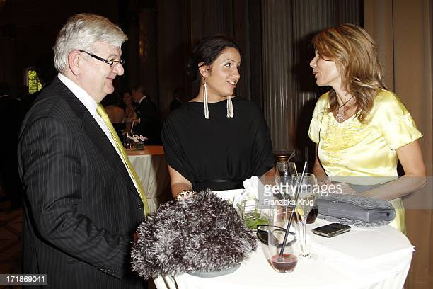 Joschka Fischer with wife Minu BaratiFischer and Ursula Karven at the notion of Eugene Onegin at the Opera for All Unter Den Linden in Berlin