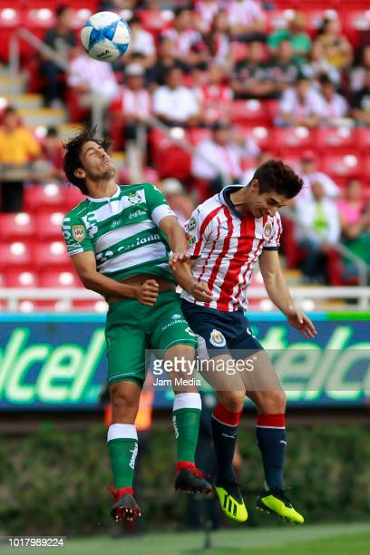 Jose Abella of Santos and Isaac Brizuela of Chivas fight for the ball during the fourth round match between Chivas and Santos Laguna as part of the...