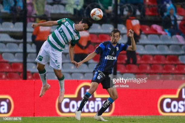 Jose Abella of Santos and Jordi Cortizo of Queretaro fight for the ball during a 15th round match between Queretaro and Santos Laguna as part of...