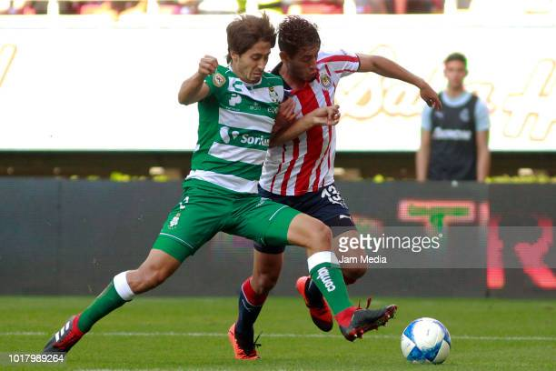 Jose Abella of Santos and Walter Sandoval of Chivas fight for the ball during the fourth round match between Chivas and Santos Laguna as part of the...