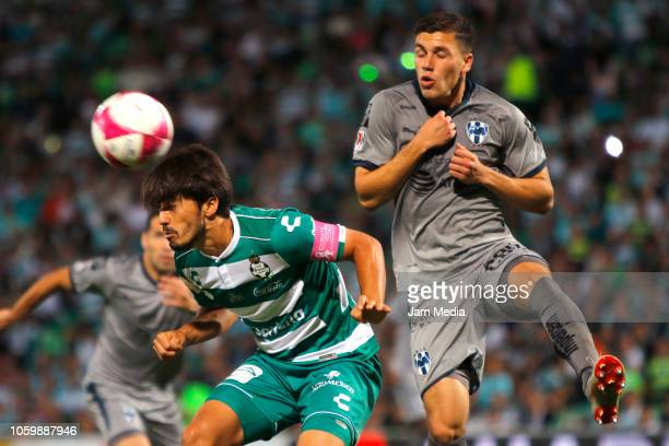 Jose Abella of Santos fights for the ball with Axel Grijalva of Monterrey during a 14th round match between Santos Laguna and Monterrey as part of...