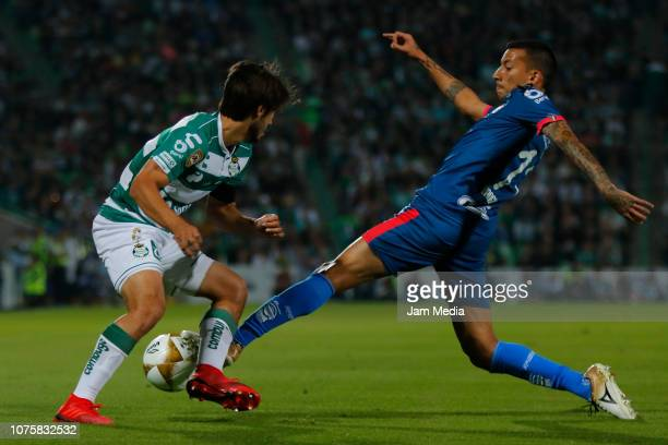 Jose Abella of Santos fights for the ball with Leonel Vangioni of Monterrey during the quarter finals second leg match between Santos Laguna and...