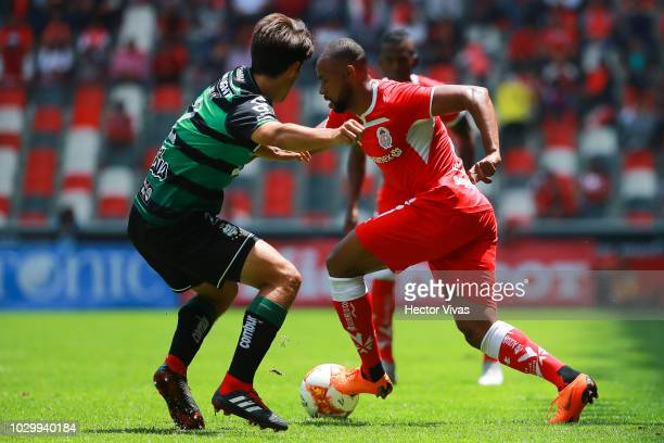 Jose Abella of Santos Laguna struggles for the ball with William Da Silva of Toluca during the 8th round match between Toluca and Santos Laguna as...