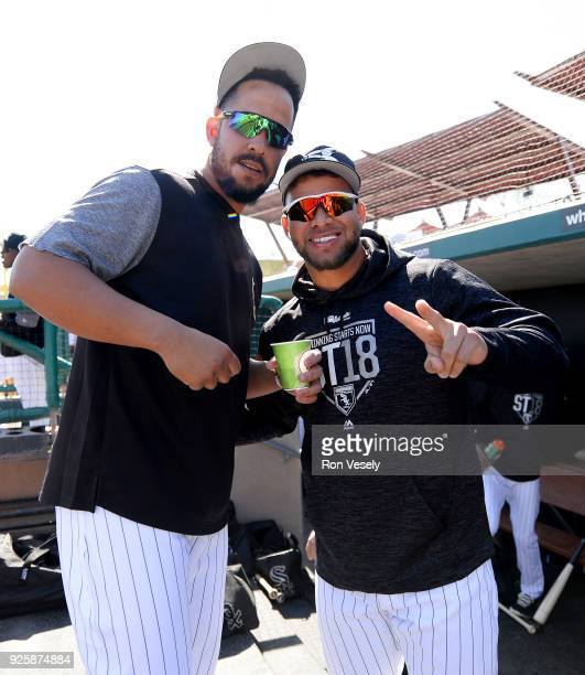 Jose Abreu and Yoan Moncada of the Chicago White Sox have fun in the dugout prior to the game against the Oakland Athletics on February 26 2018 at...