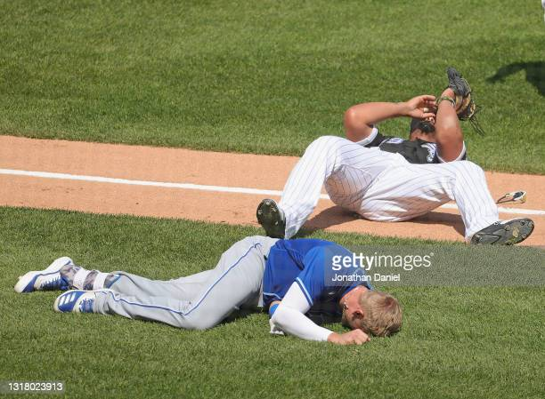 Jose Abreu of the Chicago White Sox and Hunter Dozier of the Kansas City Royals lie on the ground after a hard collision in the 2nd inning at...