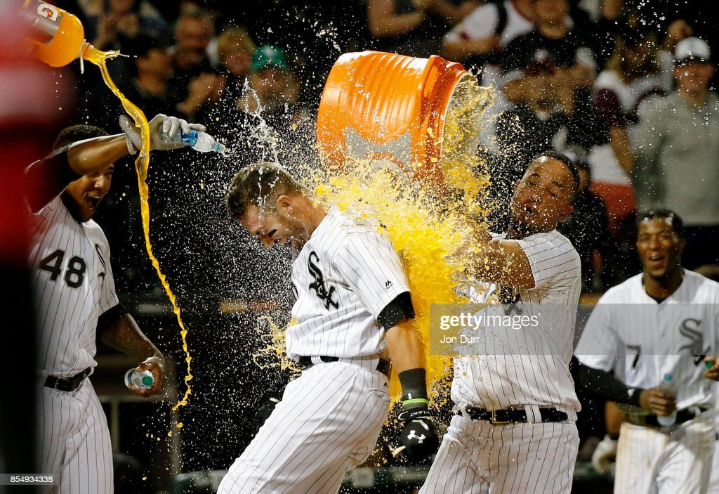 Jose Abreu #79 of the Chicago White Sox (R) and Rymer Liriano #48 (L) dunks Nicky Delmonico #30 after he hit a walkoff two run home run against the Los Angeles Angels of Anaheim during the tenth inning at Guaranteed Rate Field on September 27, 2017 in Chicago, Illinois. The Chicago White Sox won 6-4.