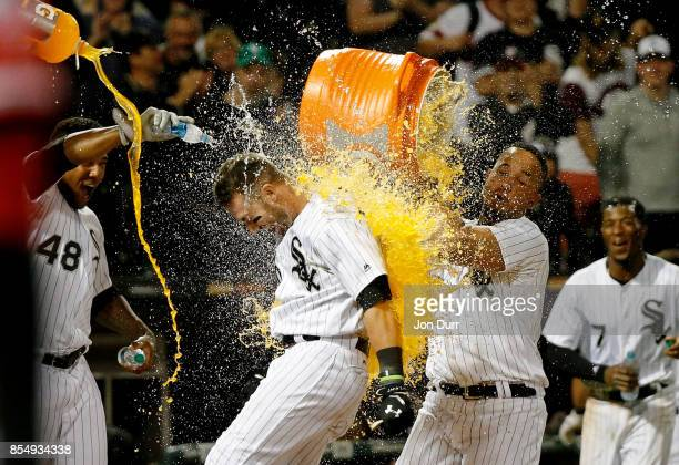 Jose Abreu of the Chicago White Sox and Rymer Liriano dunks Nicky Delmonico after he hit a walkoff two run home run against the Los Angeles Angels of...