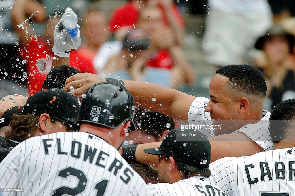 Jose Abreu #79 of the Chicago White Sox (R) and the team celebrate a walkoff homerun by Gordon Beckham #15 at U.S. Cellular Field on June 21, 2015 in Chicago, Illinois. The Chicago White Sox won 3-2 in eleven innings.