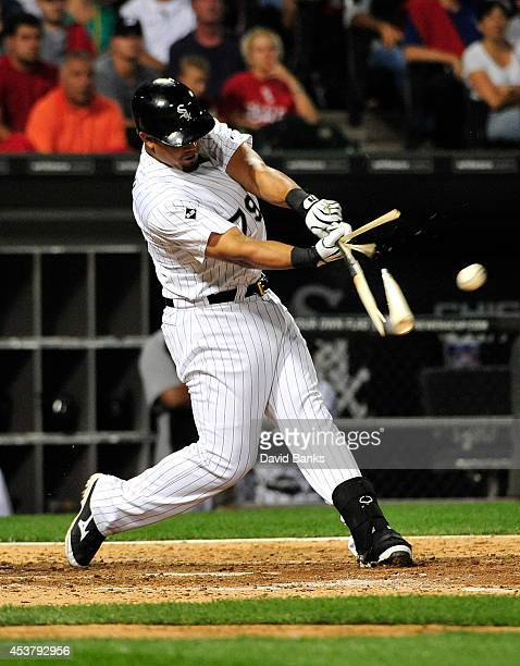 Jose Abreu of the Chicago White Sox breaks his bat against the Baltimore Orioles during the seventh inning on August 18 2014 at U S Cellular Field in...