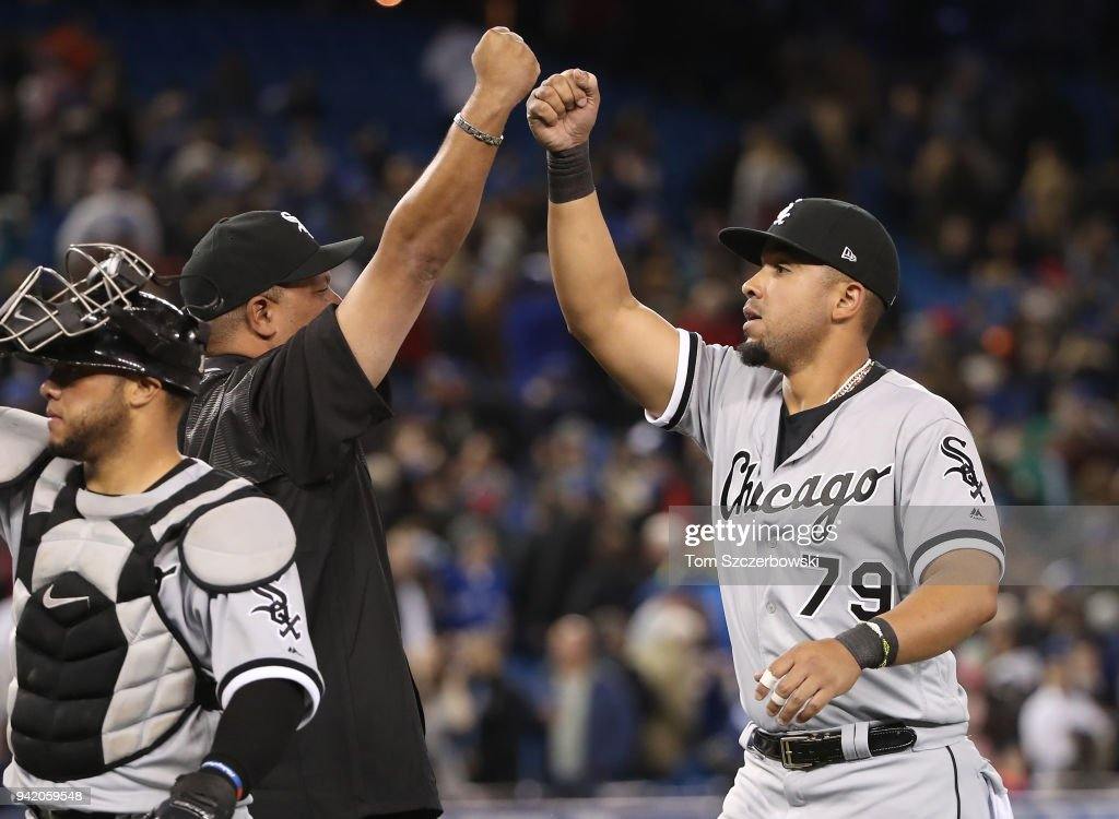 Jose Abreu #79 of the Chicago White Sox celebrates a win over the Toronto Blue Jays with hitting coach Todd Steverson #31 at Rogers Centre on April 4, 2018 in Toronto, Canada.