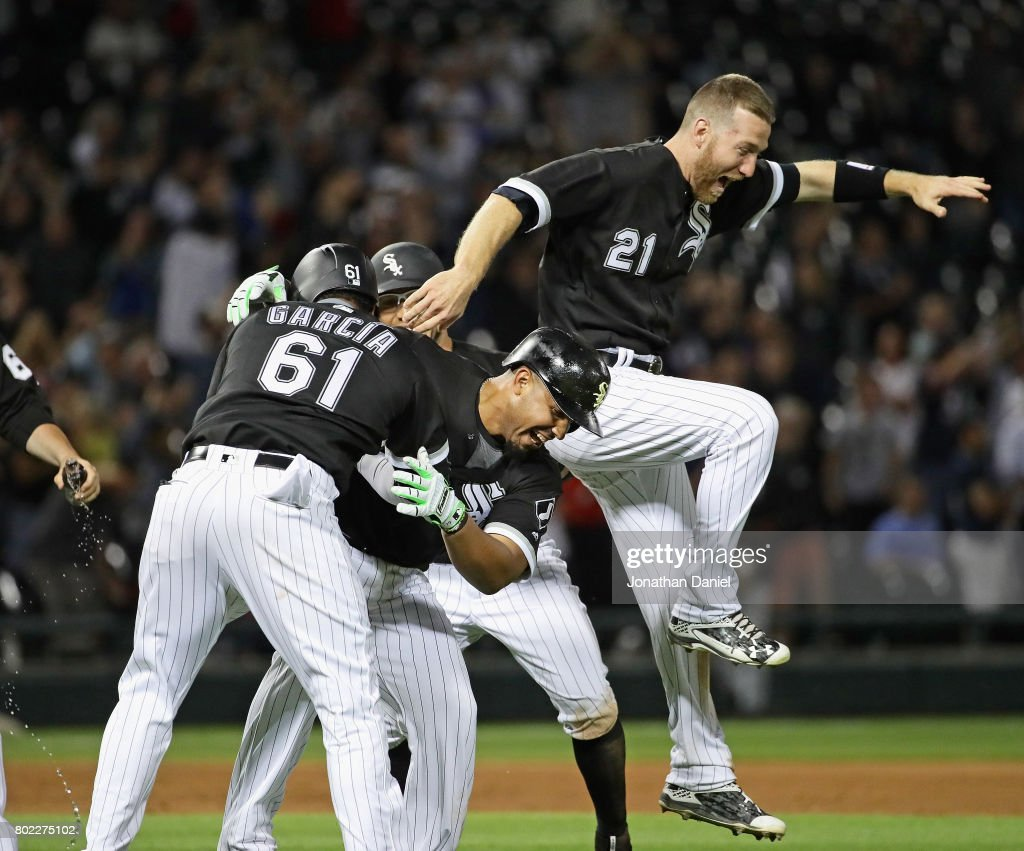 Jose Abreu #79 of the Chicago White Sox celebrates his two run, game winning double in the 9th inning with Willy Garcia #61 and Todd Frazier #21 against the New York Yankees at Guaranteed Rate Field on June 27, 2017 in Chicago, Illinois. The White Sox defeated the Yankees 4-3.