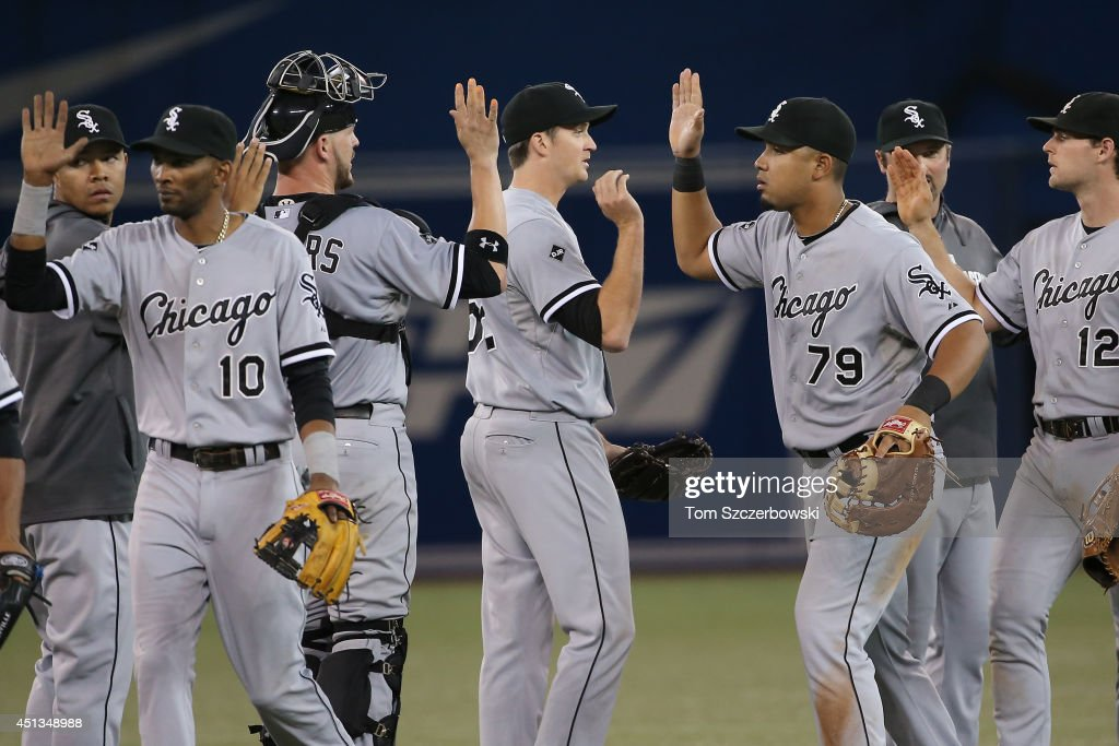 Jose Abreu #79 of the Chicago White Sox celebrates their victory with Jake Petricka #52 during MLB game action against the Toronto Blue Jays on June 27, 2014 at Rogers Centre in Toronto, Ontario, Canada.