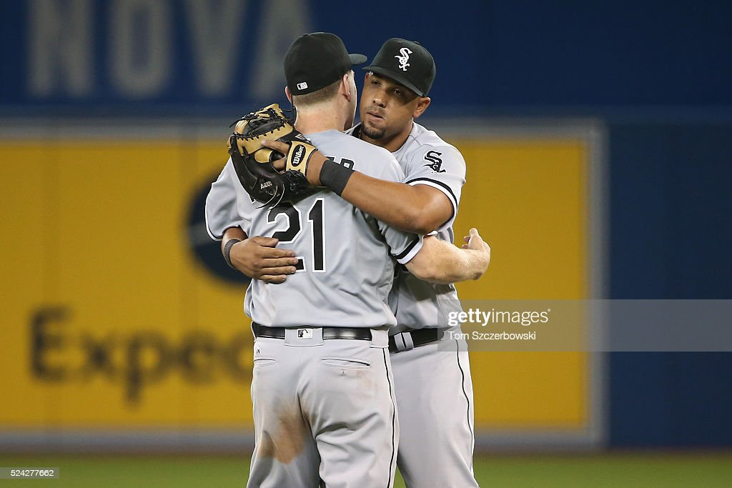 Jose Abreu #79 of the Chicago White Sox celebrates their victory with Todd Frazier #21 during MLB game action against the Toronto Blue Jays on April 25, 2016 at Rogers Centre in Toronto, Ontario, Canada.