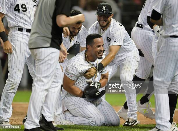 Jose Abreu of the Chicago White Sox celebrates with teammates after hitting a walkoff home run in the 12th inning against the Detroit Tigers during...