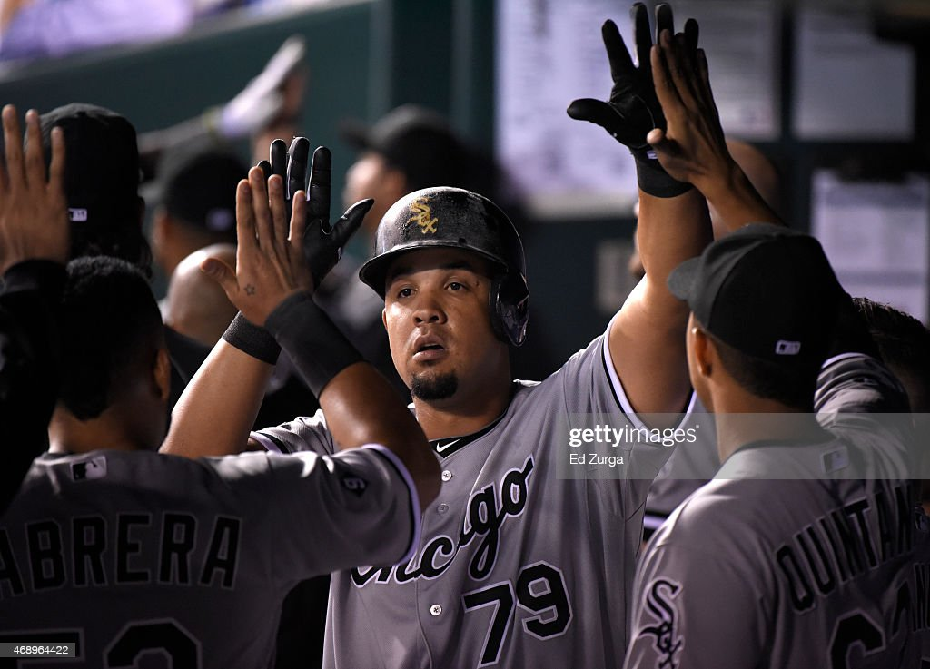 Jose Abreu #79 of the Chicago White Sox celebrates with teammates after scoring on an Alexei Ramirez sacrifice in the sixth inning against the Kansas City Royals on April 8, 2015 at Kauffman Stadium in Kansas City, Missouri.