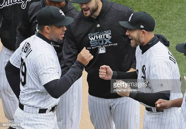 Jose Abreu of the Chicago White Sox greets Nicky Delmonico during player introductions before the Opening Day home game against the Detroit Tigers at...