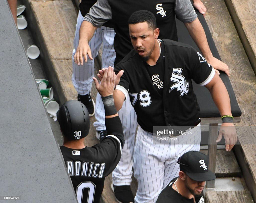 Jose Abreu #79 of the Chicago White Sox greets Nicky Delmonico #30 of the Chicago White Sox after Delmonico scored against the Minnesota Twins during the fifth inning in game one of a doubleheader on August 21, 2017 at Guaranteed Rate Field in Chicago, Illinois.