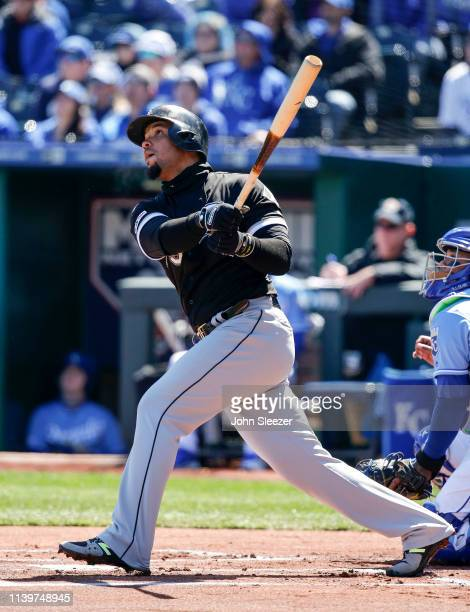 Jose Abreu of the Chicago White Sox hits a fly ball out in the first inning during the game against the Kansas City Royals at Kauffman Stadium on...