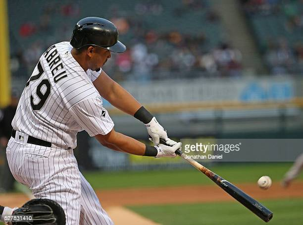 Jose Abreu of the Chicago White Sox hits a run scoring triple in the 1st inning against the Boston Red Sox at US Cellular Field on May 3 2016 in...