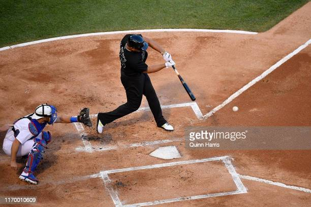 Jose Abreu of the Chicago White Sox hits a single in the first inning for his 1000th career hit during the game against the Texas Rangers at...