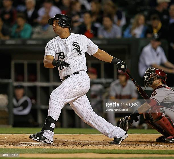 Jose Abreu of the Chicago White Sox hits a solo home run in the 7th inning against the Arizona Diamondbacks at US Cellular Field on May 9 2014 in...