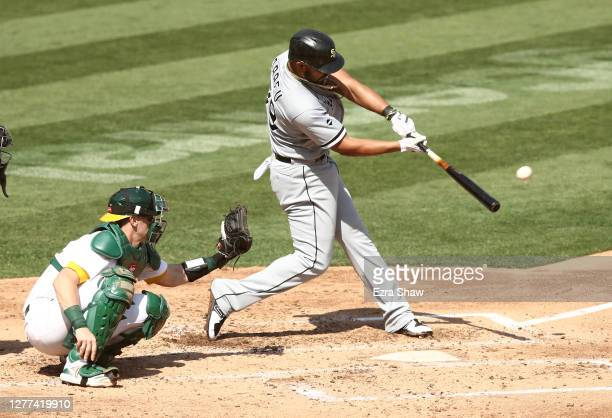Jose Abreu of the Chicago White Sox hits a two-run home run against the Oakland Athletics in the third inning of Game One of the American League wild...