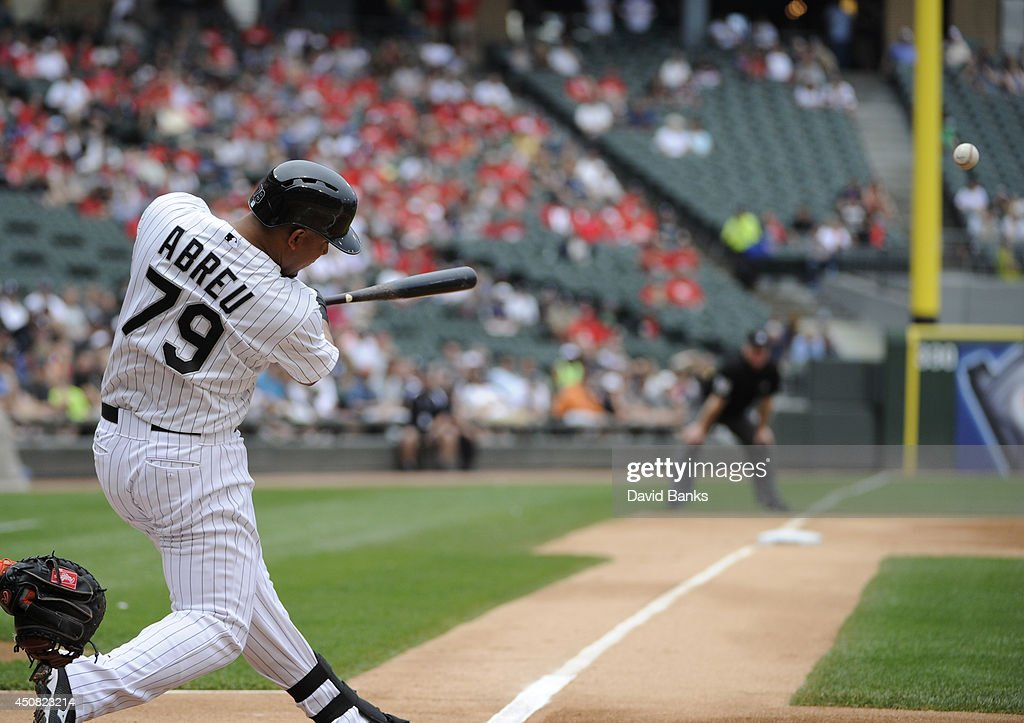 Jose Abreu #79 of the Chicago White Sox hits a two-run homer against the San Francisco Giants during the first inning on June 18, 2014 at U.S. Cellular Field in Chicago, Illinois.