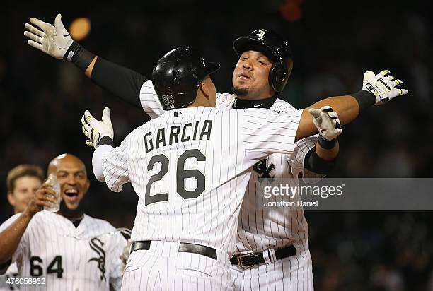 Jose Abreu of the Chicago White Sox hugs Avisail Garcia after Garcia was hits a by a pitch to walk in the winning run against the Detroit Tigers at...