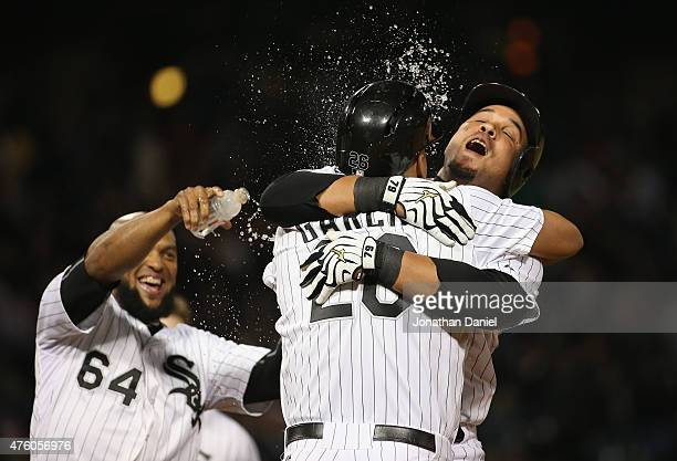 Jose Abreu of the Chicago White Sox hugs Avisail Garcia after Garcia was hits a by a pitch to walk in the winning run against the Detroit Tigers as...