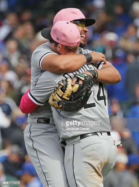 Jose Abreu of the Chicago White Sox hugs teammate Matt Davidson after a win against the Chicago Cubs at Wrigley Field on May 13 2018 in Chicago...
