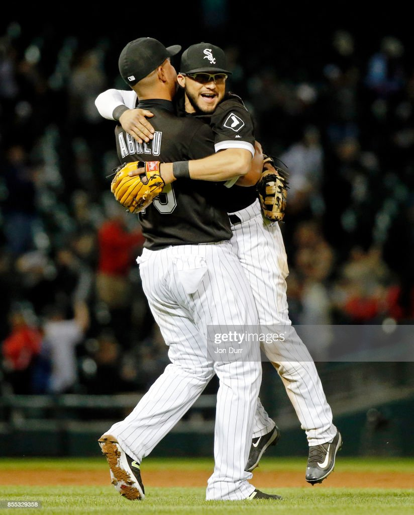 Jose Abreu #79 of the Chicago White Sox (L) hugs Yolmer Sanchez #5 after their win over the Los Angeles Angels of Anaheim at Guaranteed Rate Field on September 28, 2017 in Chicago, Illinois. The Chicago White Sox won 5-4.