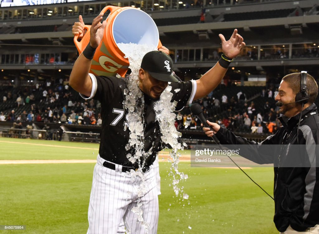 Jose Abreu #79 of the Chicago White Sox is doused with ice by Avisail Garcia #26 after hitting for the cycle against the San Francisco Giants on September 9, 2017 at Guaranteed Rate Field in Chicago, Illinois.The White Sox won 13-1.