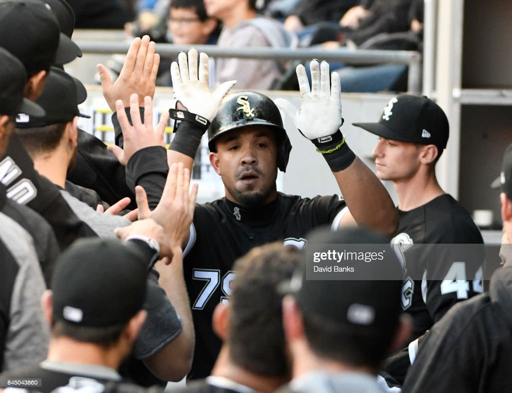 Jose Abreu (C) of the Chicago White Sox is greeted by his teammates after hitting a home run against the San Francisco Giants during the first inning on September 9, 2017 at Guaranteed Rate Field in Chicago, Illinois.