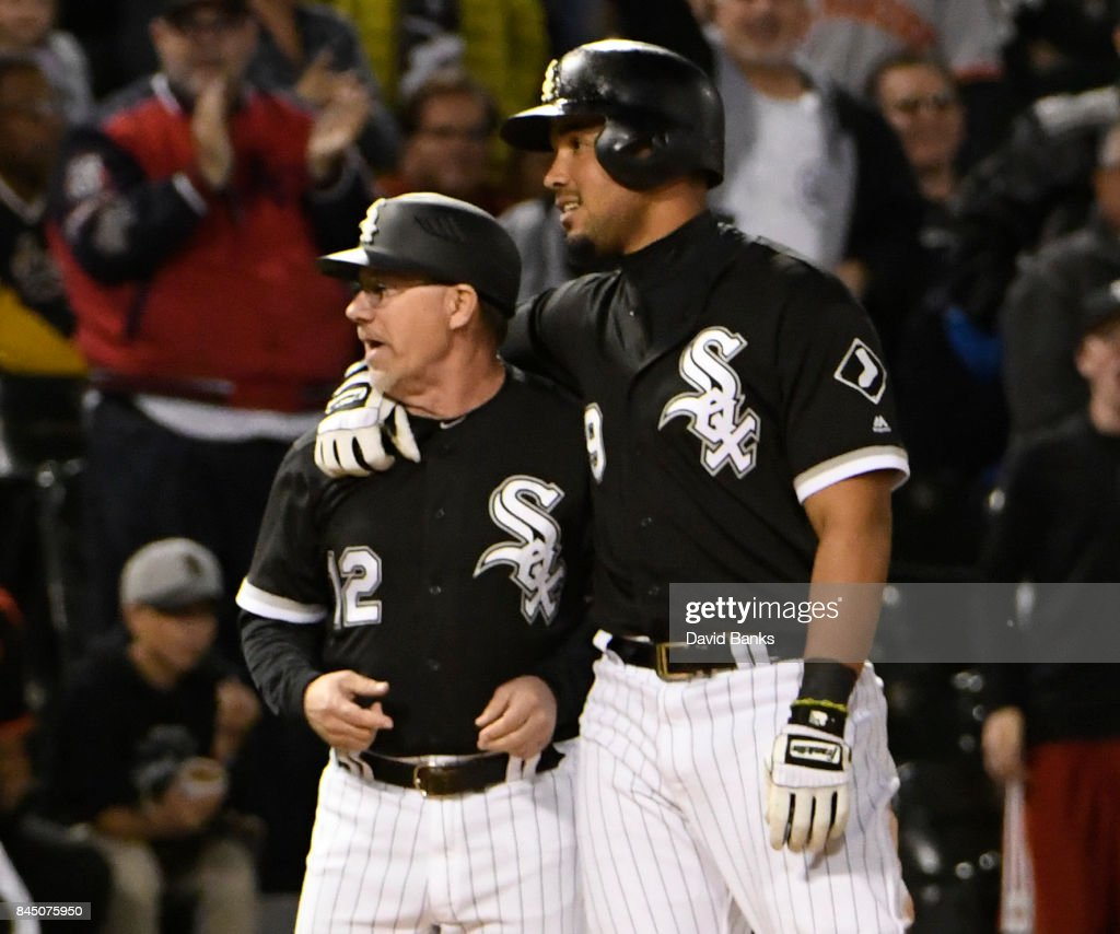 Jose Abreu #79 of the Chicago White Sox is greeted by Nick Capra #12 after hitting a triple against the San Francisco Giants during the eighth inning on September 9, 2017 at Guaranteed Rate Field in Chicago, Illinois. Abreu's triple completed the cycle.