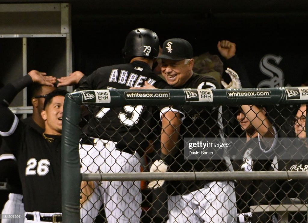 Jose Abreu #79 of the Chicago White Sox is greeted in the dugout after hitting a triple against the San Francisco Giants during the eighth inning on September 9, 2017 at Guaranteed Rate Field in Chicago, Illinois. Abreu's triple completed the cycle.