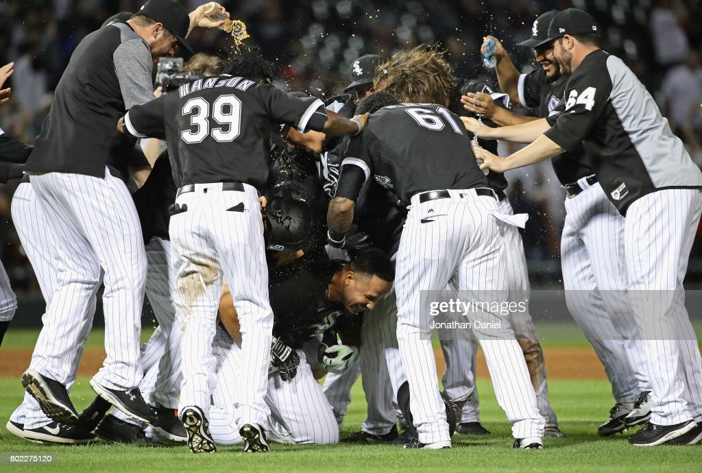 Jose Abreu #79 of the Chicago White Sox (on ground) is mobbed by teammates after hitting a two run, game winning double in the 9th inning against the New York Yankees at Guaranteed Rate Field on June 27, 2017 in Chicago, Illinois. The White Sox defeated the Yankees 4-3.