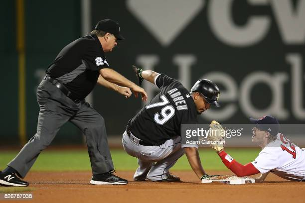 Jose Abreu of the Chicago White Sox is safe at second base after dodging the tag of Brock Holt of the Boston Red Sox in the eighth inning of a game...