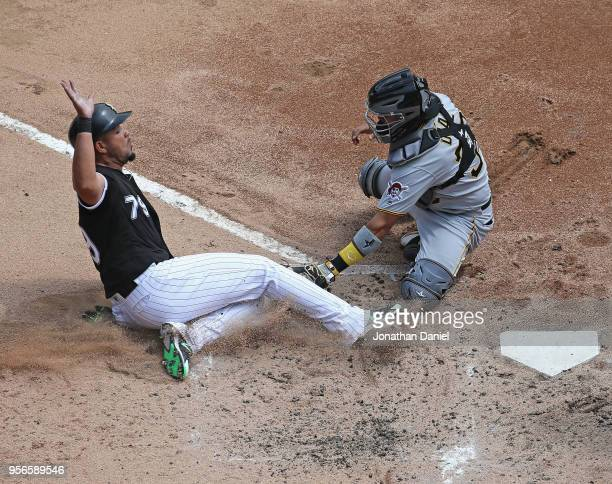 Jose Abreu of the Chicago White Sox is tagged out at the plate by Elias Diaz of the Pittsburgh Pirates to end the third inning at Guaranteed Rate...
