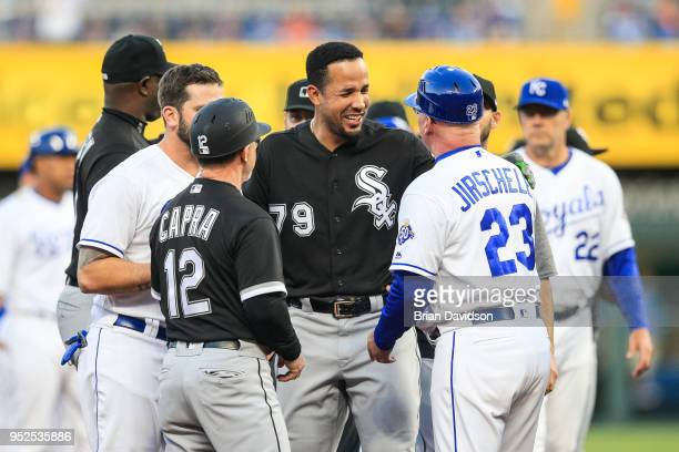 Jose Abreu of the Chicago White Sox laughs with Mike Jirschele of the Kansas City Royals after the benches cleared during the first inning of game...