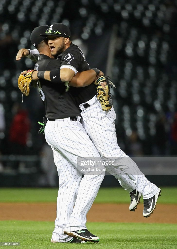 Jose Abreu #79 of the Chicago White Sox (L) lifts up Yolmer Sanchez #5 after Sanchez got the game winning hit after the game against the Baltimore Orioles at Guaranteed Rate Field on May 22, 2018 in Chicago, Illinois. The White Sox defeated the Orioles 3-2.