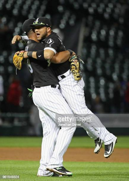 Jose Abreu of the Chicago White Sox lifts up Yolmer Sanchez after Sanchez got the game winning hit after the game against the Baltimore Orioles at...