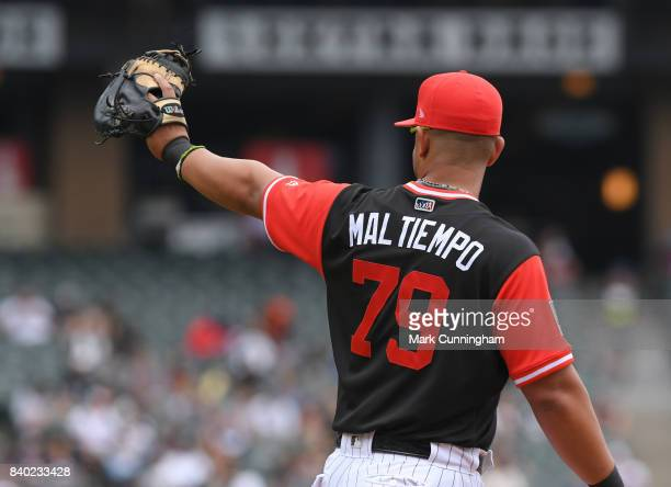 Jose Abreu of the Chicago White Sox looks on while wearing a special uniform with his nickname Mal Tiempo on the back to celebrate Players Weekend...