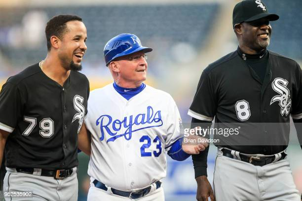 Jose Abreu of the Chicago White Sox Mike Jirschele of the Kansas City Royals and Daryl Boston of the Chicago White Sox smile and laugh after a bench...