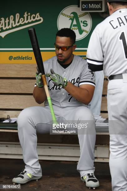 Jose Abreu of the Chicago White Sox puts pine tar on his bat prior to in the dugout the game against the Oakland Athletics at the Oakland Alameda...