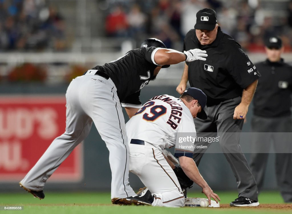 Jose Abreu #79 of the Chicago White Sox reaches second base on a double as Trevor Hildenberger #39 of the Minnesota Twins is unable to field the ball during the seventh inning of the game on August 29, 2017 at Target Field in Minneapolis, Minnesota. The Twins defeated the White Sox 6-4.