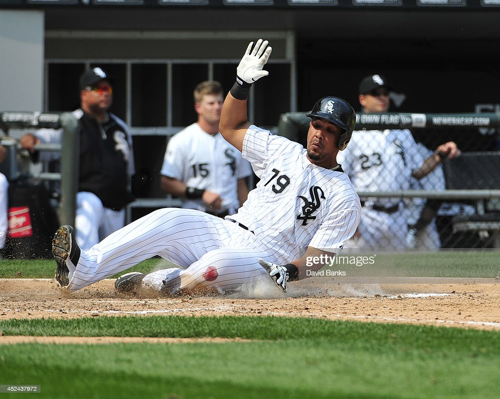 Jose Abreu #79 of the Chicago White Sox scores against the Houston Astros during the sixth inning on July 20, 2014 at U.S. Cellular Field in Chicago, Illinois.